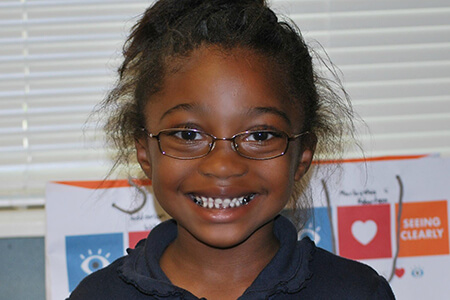 girl in glasses smiling